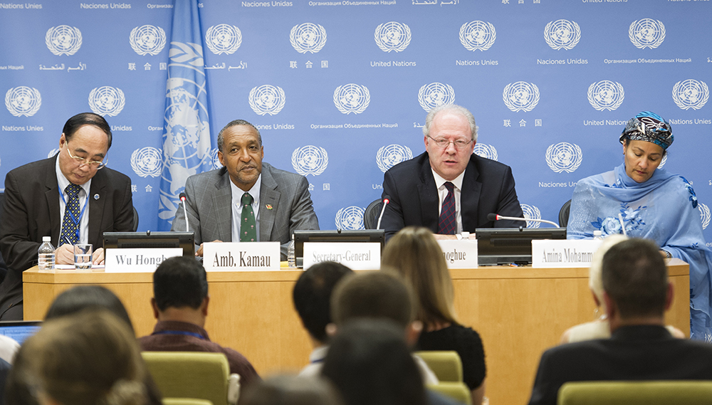 The Permanent Representatives of Kenya and Ireland (center left and center right) announce the adoption of the document at a press conference in UN headquarters on Sunday. Photo: UN Photo